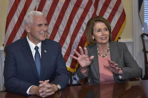 House Minority Leader Nancy Pelosi D-CA, and US Vice President-elect Mike Pence speak to the media following a meeting at the US Capitol on November 17, 2016 in Washington, DC. / AFP PHOTO / MANDEL NGANMANDEL NGAN/AFP/Getty Images