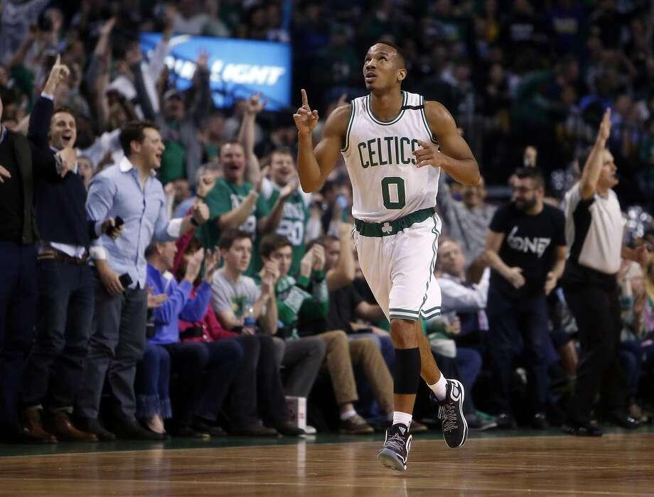 Boston Celtics' Avery Bradley celebrates a 3-pointer in 1st quarter against Golden State Warriors during NBA game at TD Garden in Boston, Massachusetts on Friday, December 11, 2015. Photo: Scott Strazzante, The Chronicle
