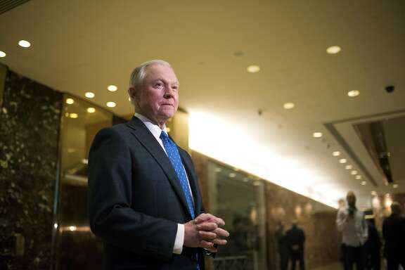FILE-- Sen. Jeff Sessions (R-Ala.) speaks to reporters in the Trump Tower lobby on Fifth Avenue in Manhattan, Nov. 17, 2016. Trump selected Sessions, who has made cracking down on undocumented immigrants a signature issue, to be his attorney general, while installing Michael Flynn, a retired lieutenant general who believes Islamist militancy poses an existential threat, as his national security adviser. (Hilary Swift/The New York Times)