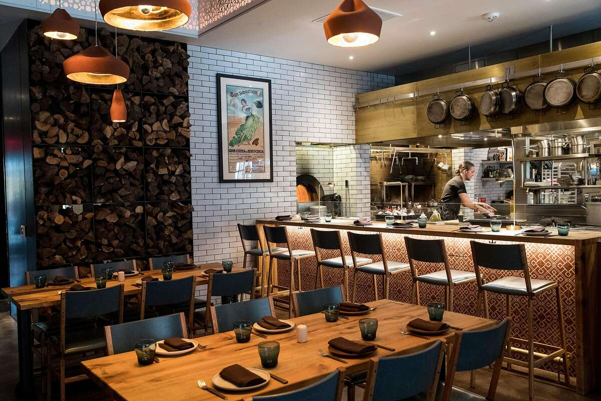 Part of the dining room that looks onto the open kitchen is seen at Bellota, a new Spanish cuisine restaurant in SoMa by the Absinthe Group, in San Francisco, Calif., on Thursday, November 17, 2016. Interior designer Kendall Wilkinson worked on the restaurant's design.