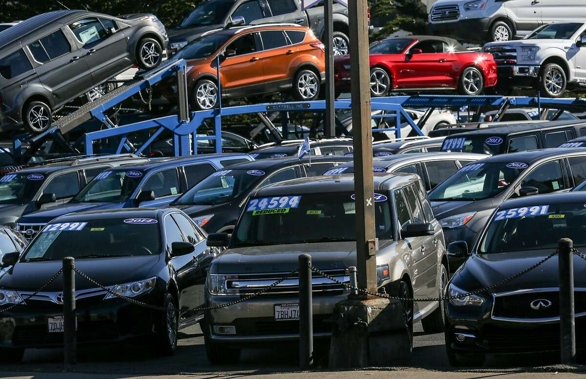 Cars displayed at a car dealership on Serramonte Blvd on Friday, November 18, 2016 in Daly City, Calif.