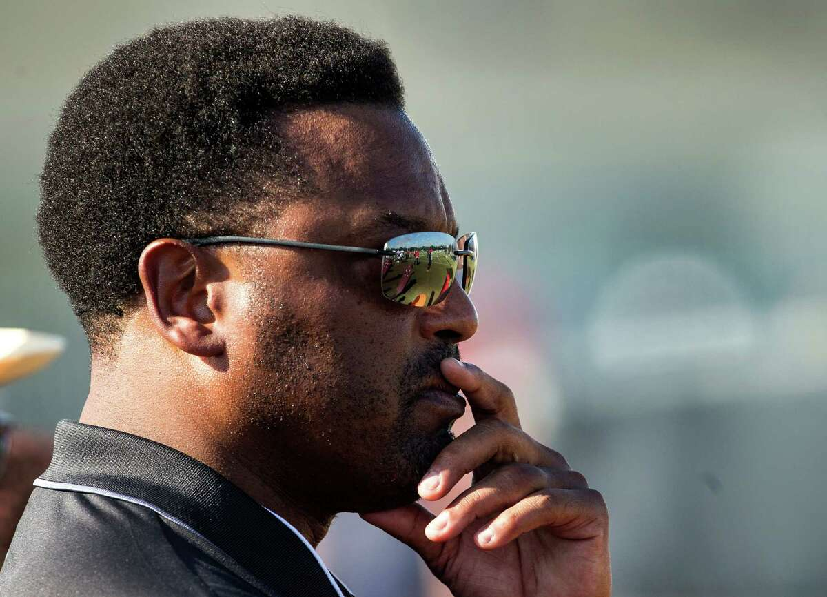 Texas A&M football coach Kevin Sumlin watches Houston Texans practice during Texans training camp at Houston Methodist Training Center on Tuesday, Aug. 2, 2016, in Houston. ( Brett Coomer / Houston Chronicle )
