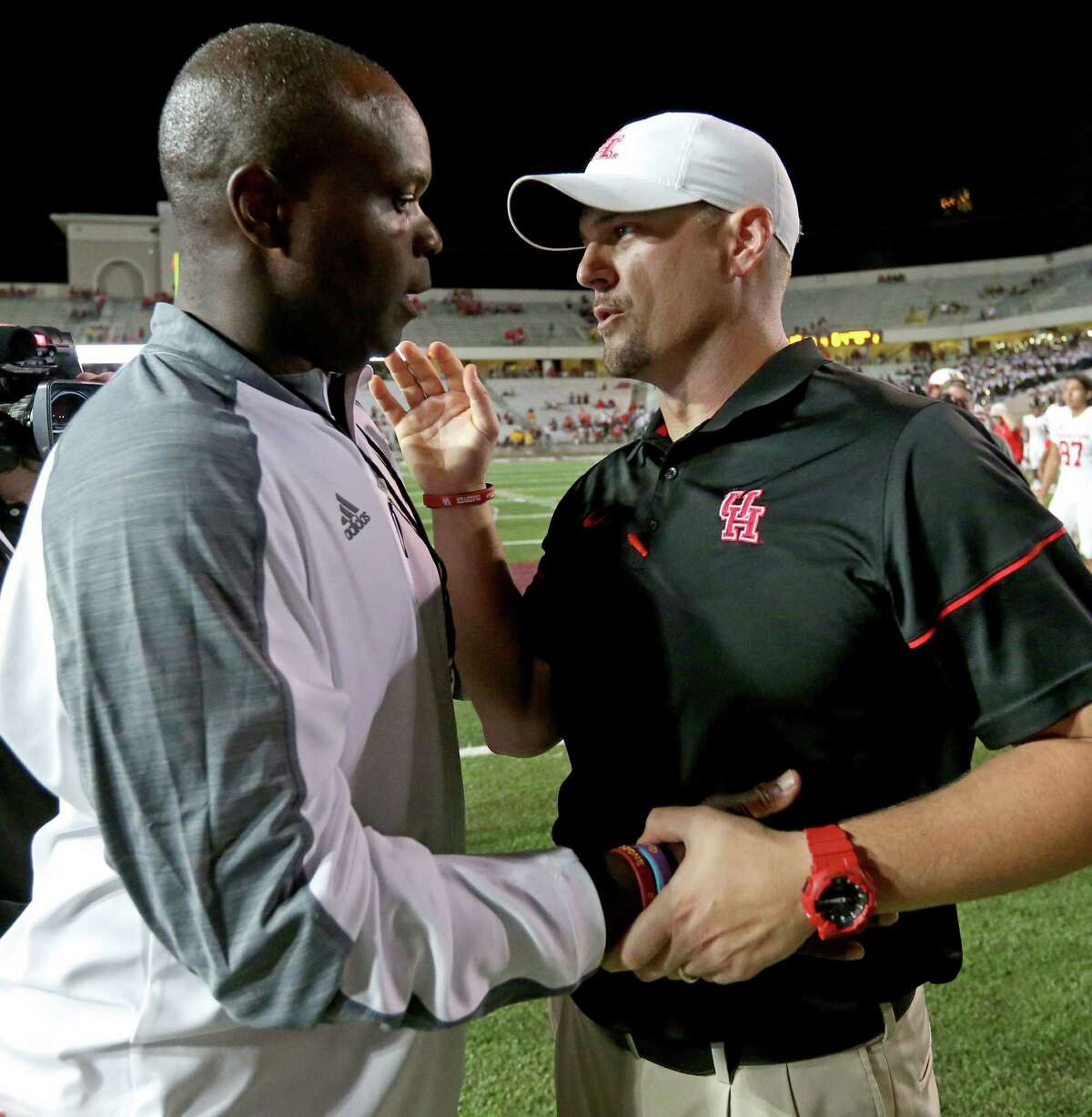 Texas State Bobcats head coach Everett Withers (left) and Houston Cougars head coach Tom Herman talk after the game Saturday Sept. 24, 2016 at Bobcat Stadium in San Marcos, Tx. The Houston Cougars won 64-3.