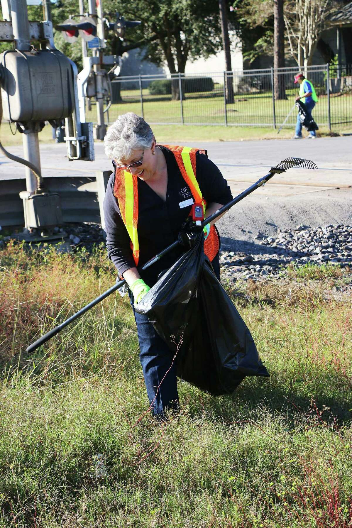 Liberty Woman's Club president Helen Lamberth led her club to a Pickup and Pitch In cleanup event on Tuesday. The volunteers collected trash along MLK and Texas.