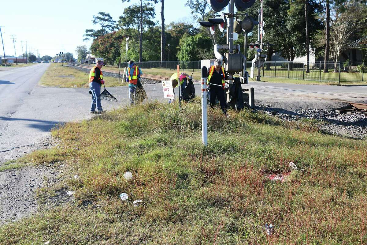 There was plenty of trash located around the railroad crossing arms. Helping clear the area is Sharon McClelland (Liberty Woman's Club), Lisa Meisch, (LWC), Roberta Thornton (Trivium Club), and Helen Lamberth (LWC).