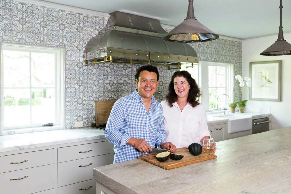 Chef Hugo Ortega and his wife, restaurateur Tracy Vaught know a thing or two about kitchens. While the kitchens in their restaurants -- Hugo's, Backstreet Cafe, and Caracol -- are commercial grade, the kitchen in their River Oaks home is both functional and beautiful. A sizable, wood-topped island provides plenty of workspace and marble countertops provide a light surface against an ornately-tiled wall. The room's jewelry? A custom-made range hood.