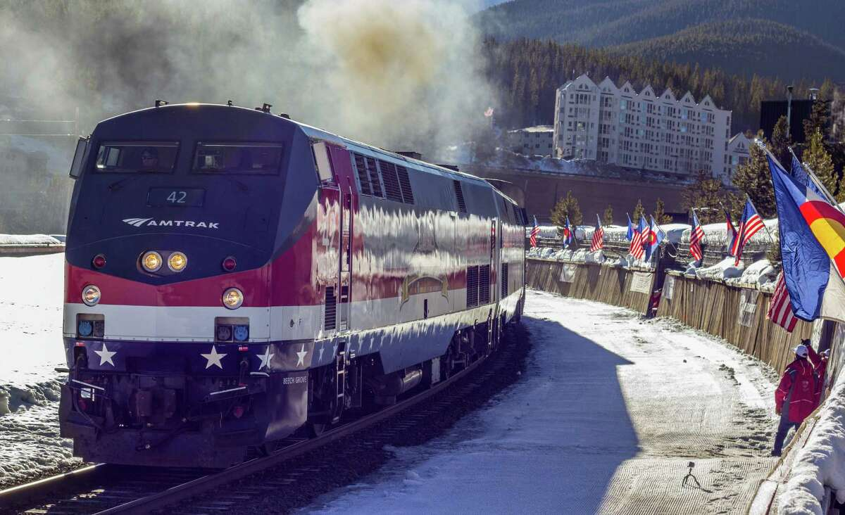 In this March 14, 2015, photo provided by Winter Park Ski Resort, the Winter Park ski train is shown outside Winter Park, Colo. The historic train for skiers is resuming service from Denver's Union Station to the Rocky Mountains through 29 tunnels. (Carl Frey/Winter Park Resort via AP)
