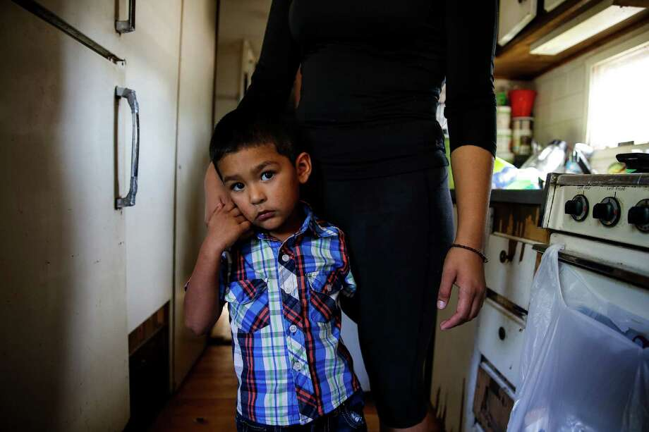 Kevin Garza Garibaldi, 2, hangs onto his mother, Yesenia Garibaldi, in his grandmothers trailer in the Pueblo de Palmas colonia Tuesday, Nov. 15, 2016 in Penitas. Photo: Michael Ciaglo, Houston Chronicle / © 2016  Houston Chronicle