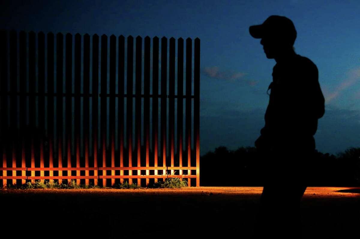 A Border Patrol agent guards a gap in the border fence Monday, Nov. 14, 2016 in Penitas.