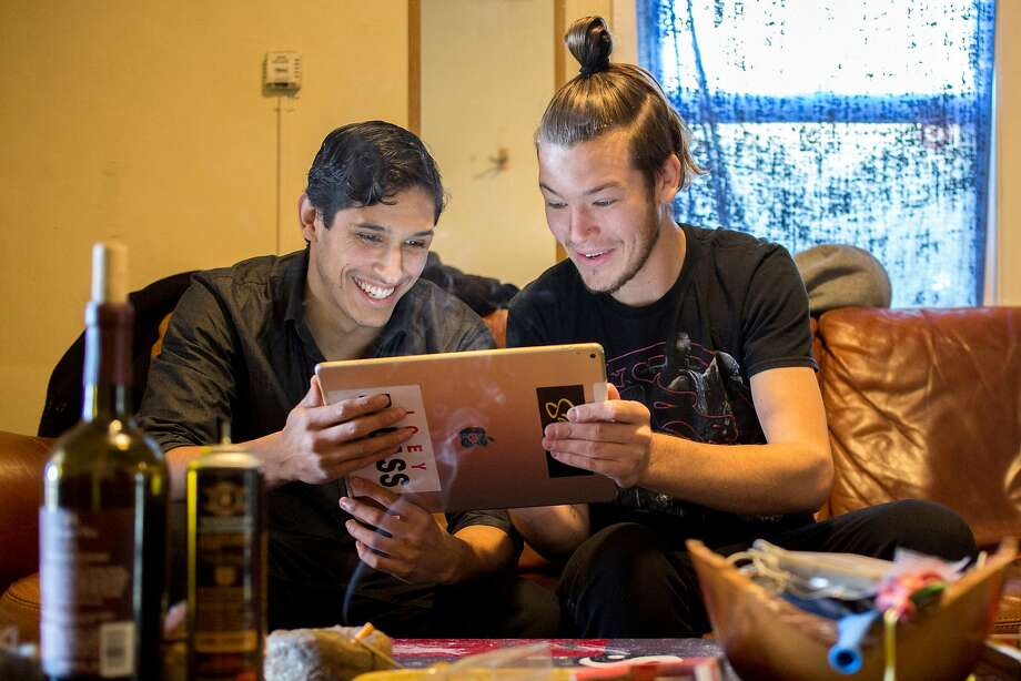 From left: Christian Buenrostro, age 23, hangs out at Josh Benson's home on Friday, Nov. 18, 2016 in San Francisco, Calif. Buenrostro is an undocumented student from Mexico City, Mexico. Photo: Santiago Mejia, The Chronicle