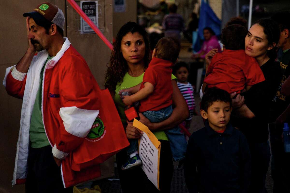 Immigrants, most of whom are escaping violence and poverty in El Salvador, Honduras and Guatemala, wait in line to make a phone call at Sacred Heart Catholic Church Tuesday, Nov. 15, 2016 in McAllen. The church assists hundreds of immigrants everyday who arrive in McAllen after crossing the border by giving them food, clothing and a place to sleep if necessary.