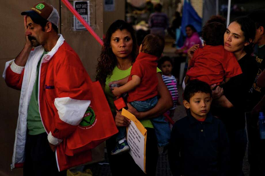 Immigrants, most of whom are escaping violence and poverty in El Salvador, Honduras and Guatemala, wait in line to make a phone call at Sacred Heart Catholic Church Tuesday, Nov. 15, 2016 in McAllen. The church assists hundreds of immigrants everyday who arrive in McAllen after crossing the border by giving them food, clothing and a place to sleep if necessary. Photo: Michael Ciaglo, Houston Chronicle / © 2016  Houston Chronicle