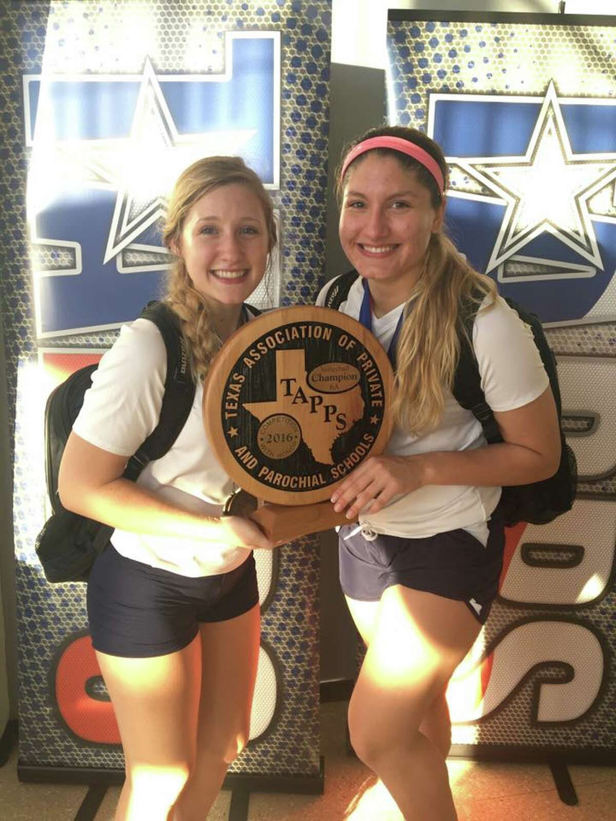 Concordia Lutheran team captains, senior setter Samantha Boatman (left) and senior outside hitter Gabi Zelaya (right), hold the TAPPS 6A State Title Trophy, following the Lady Crusaders' five-set victory over Bishop Lynch.