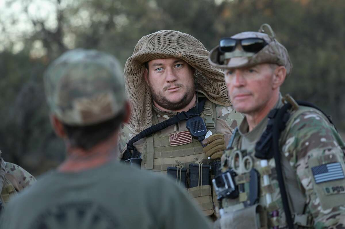 ARIVACA, AZ - NOVEMBER 14: Civilian paramilitaries with Arizona Border Recon receive instructions while on patrol near the U.S.-Mexico border on November 14, 2016 near Arivaca, Arizona. The armed group, made up mostly of former U.S. military servicemen and women, stages intelligence and reconnaissance operations against drug and human smugglers in remote border areas. The group, which claims up to 200 volunteers, does not consider itself a militia, but rather a group of citizens supplementing U.S. Border Patrol efforts to counter illegal border activity. With the election of Donald Trump as President, border security issues are a top national issue for the incoming Administration. (Photo by John Moore/Getty Images)