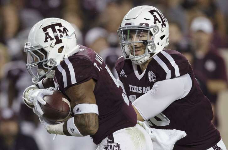 Texas A&M quarterback Jake Hubenak (right) hands off to running back Trayveon Williams during the first quarter against Mississippi on Nov. 12, 2016, in College Station.