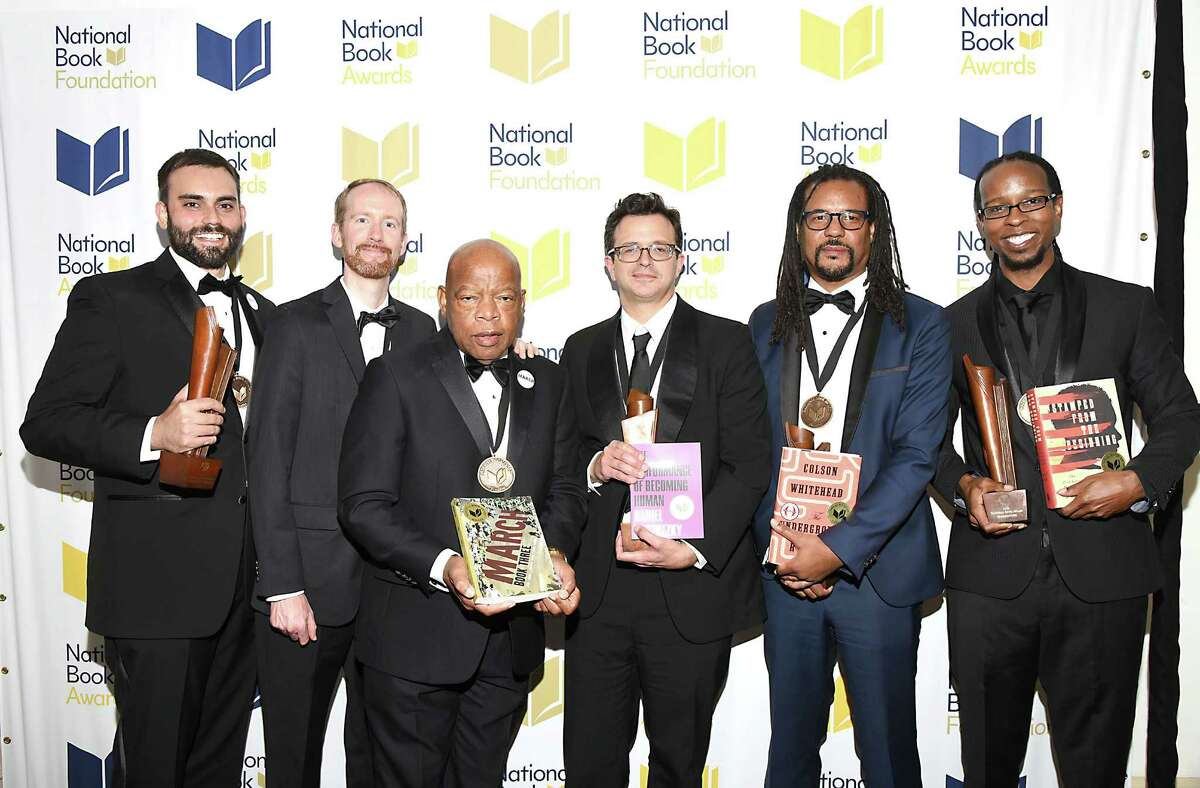 The winners of the 2016 National Book Awards are, from left, Andrew Aydin, Nate Powell and John Lewis for young people's literature;Daniel Borzutzkyfor poetry; Colson Whitehead for fiction; and Ibram X. Kendi for nonfiction.
