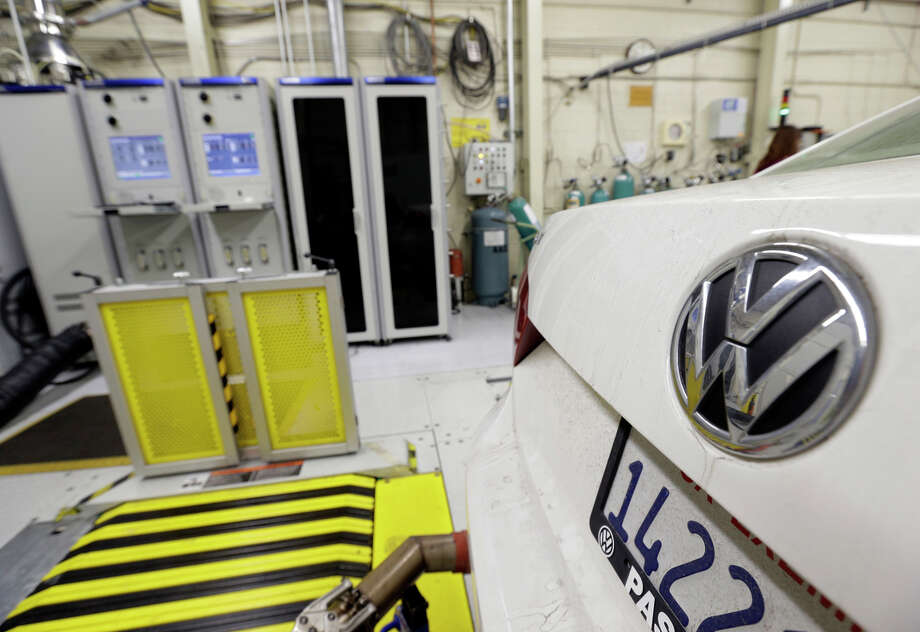 FILE - In this Sept. 30, 2015 file photo, a 2013 Volkswagen Passat with a diesel engine is evaluated at the California Air Resources Board emissions test lab in El Monte, Calif. California air quality regulators, on Tuesday, Jan. 12, 2016, rejected Volkswagen's recall plan to fix vehicles including the Beetle and Jetta that were programmed to trick government emissions tests. (AP Photo/Nick Ut, File) Photo: Nick Ut, STF / AP