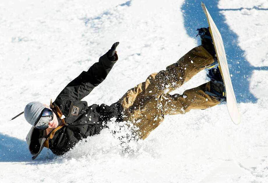 A snowboarder wipes out at  Boreal Mountain Resort on Friday, Nov. 18, 2016, in Norden, Calif. Photo: Noah Berger, Special To The Chronicle