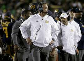 California coach Sonny Dykes watches from the sideline during the first half of the team's NCAA college football game against Oregon in Berkeley, Calif., Friday, Oct. 21, 2016. (AP Photo/Jeff Chiu)