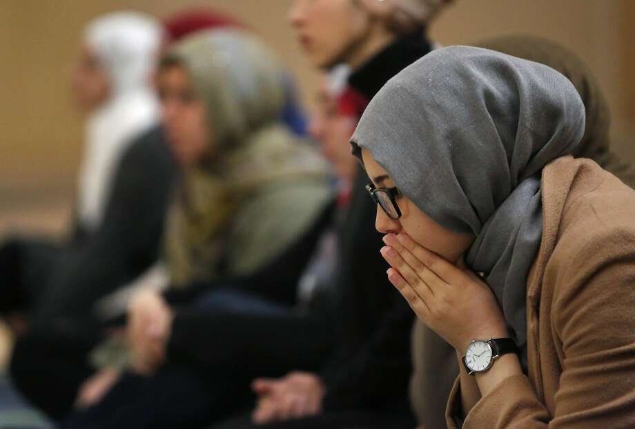 Student Sarah Bellal listens to a sermon at a prayer session at UC Berkeley. Photo: Leah Millis, The Chronicle