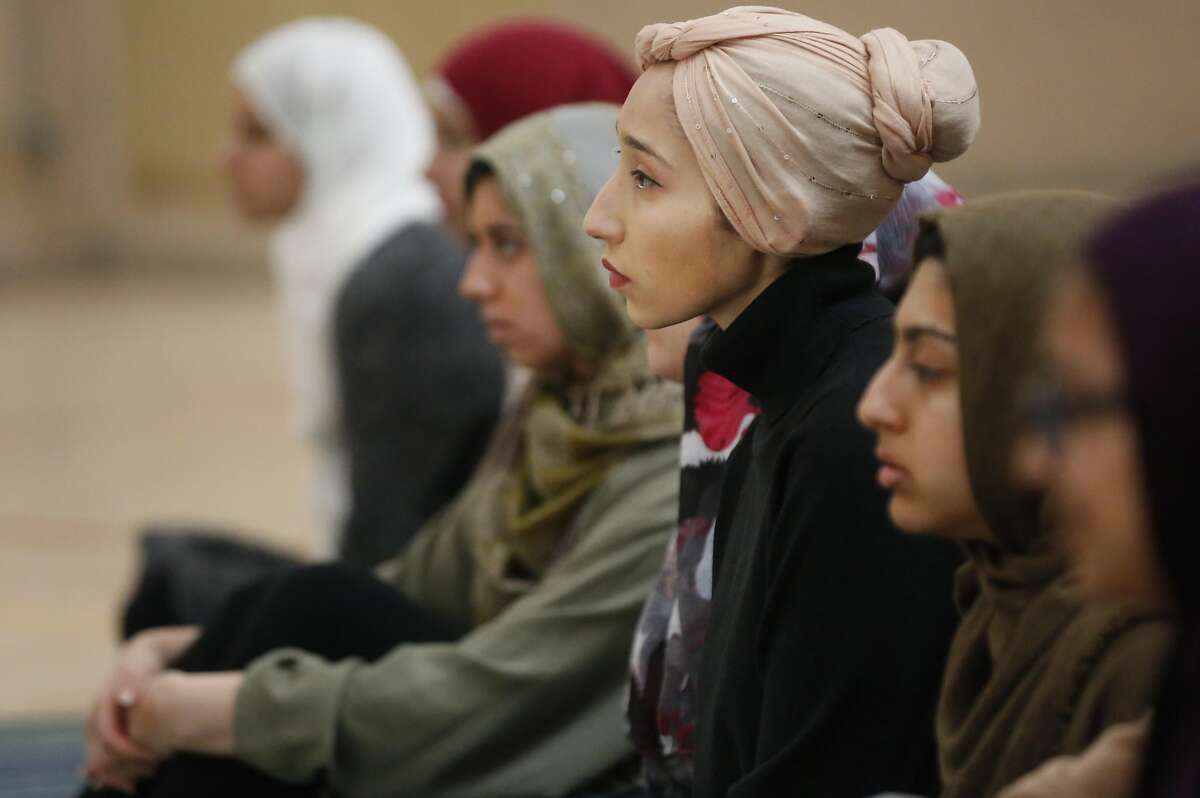 Grad student Somaya Abdelgany listens to the sermon during a prayer session held by the Muslim Student Association (Cal MSA) on the UC Berkeley campus Nov. 18, 2016 in Berkeley, Calif.
