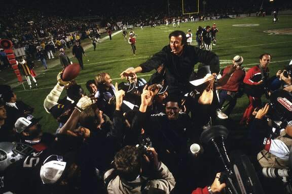 TAMPA, FL - JANUARY 22: Head Coach Tom Flores of the Los Angeles Raiders gets carried off the field after they defeated the Washington Redskins 38-9 in Super Bowl XVIII  on January 22, 1984 at Tampa Stadium in Tampa, Florida. (Photo by Focus on Sport/Getty Images)