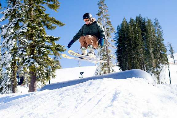 A snowboarder takes a jump at  Boreal Mountain Resort shortly after it opened for the season on Friday, Nov. 18, 2016, in Norden, Calif.