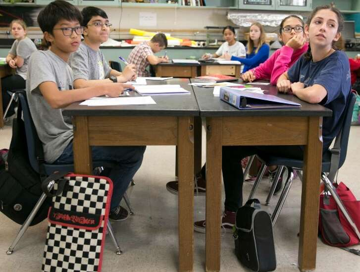 Jennie Lou Leeder said we spend more on prisons per day than we do on schools. Here we see some students at Austin's Kealing Middle School (November 2016, Jay Janner, Austin American-Statesman).