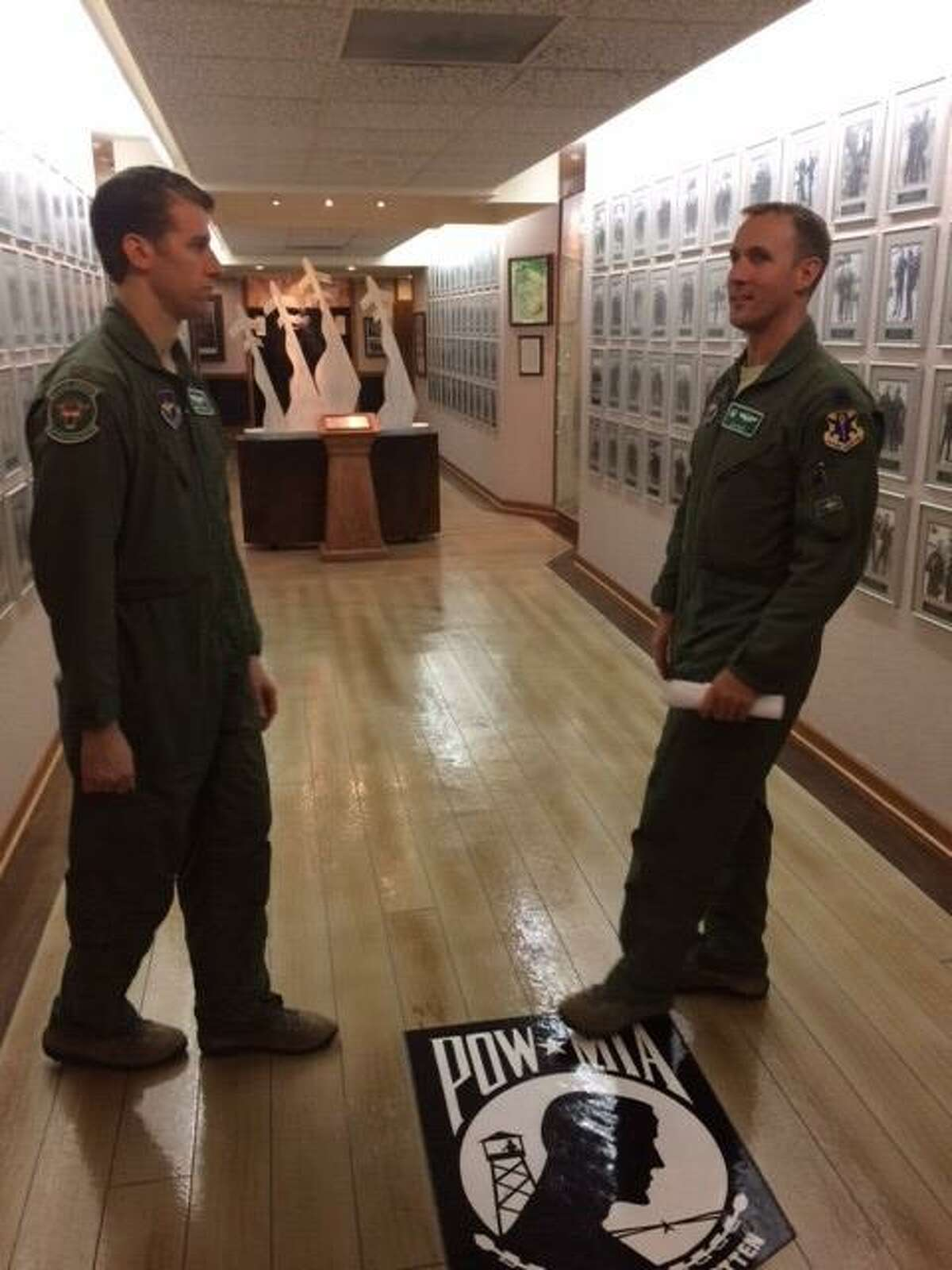 """Lt. Col. Jon """"Salty"""" Elza, right, talks with a buddy at Freedom Hall, a memorial dedicated to Air Force crewmen who were shot down and held prisoner in North Vietnam."""