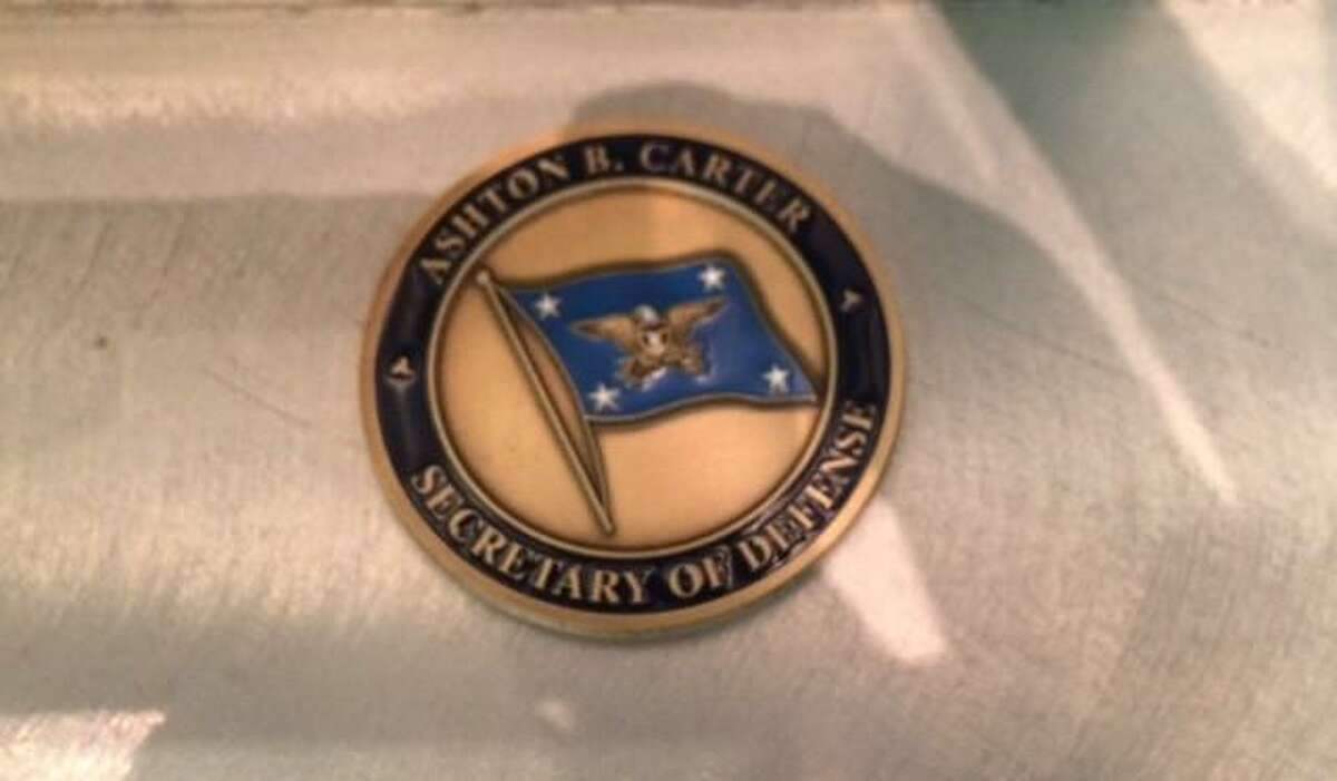"""A commemorative """"Challenge"""" coin left by U.S. Defense Secretary Ash Carter at Freedom Hall at Randolph."""