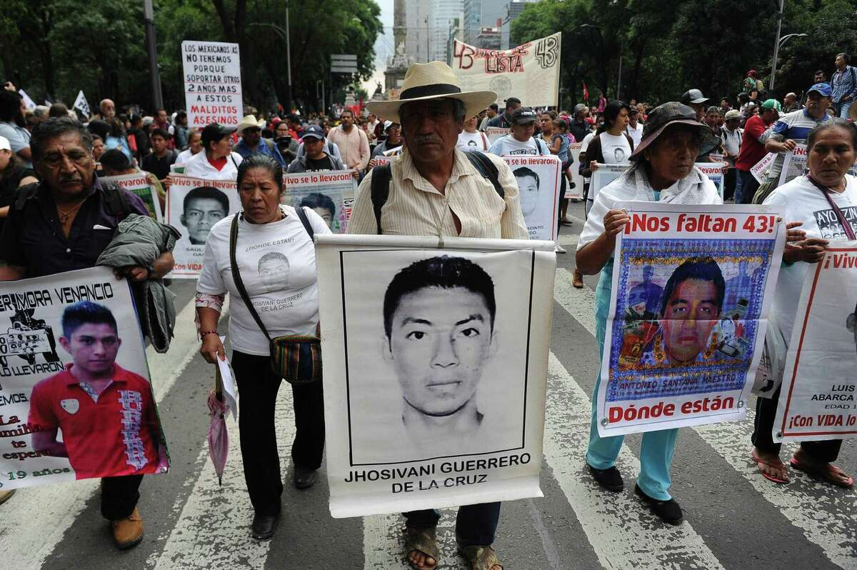 Students and relatives of the 43 missing students from Ayotzinapa take part in a protest in Mexico City, on September 26, 2016, to commemorate the second anniversary of their disappearance. The students, from a rural teachers college in the southern state of Guerrero, disappeared after they were attacked by local police in the city of Iguala on September 26, 2014.