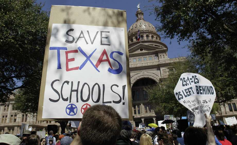 Teachers, students and parents take part in a school rally March 12, 2011 in Austin, Texas. A Texas Supreme Court ruling in the summer said that, though the state's school funding scheme was obviously lacking, it wasn't unconstitutional. Photo: Eric Gay /AP / AP