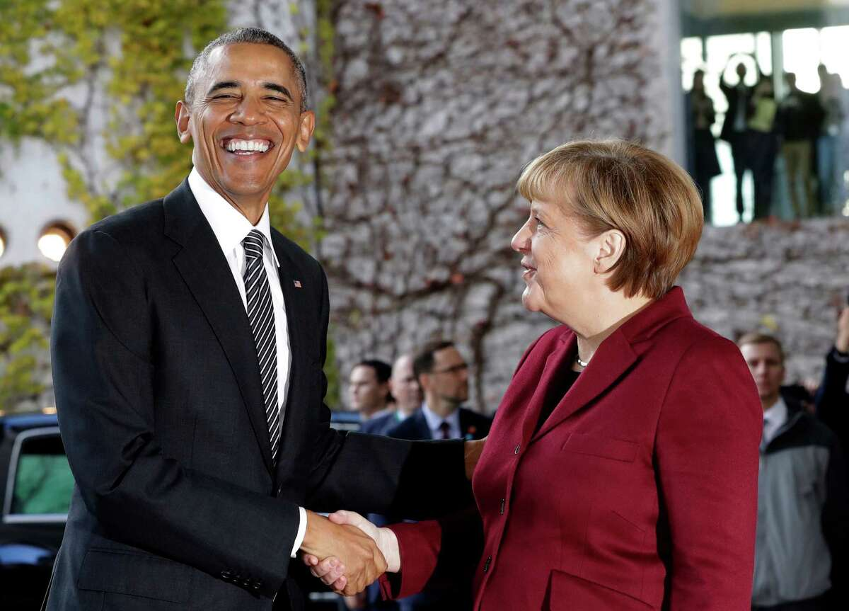 President Barack Obama is welcomed by German Chancellor Angela Merkel Friday prior to a meeting with several European leaders.