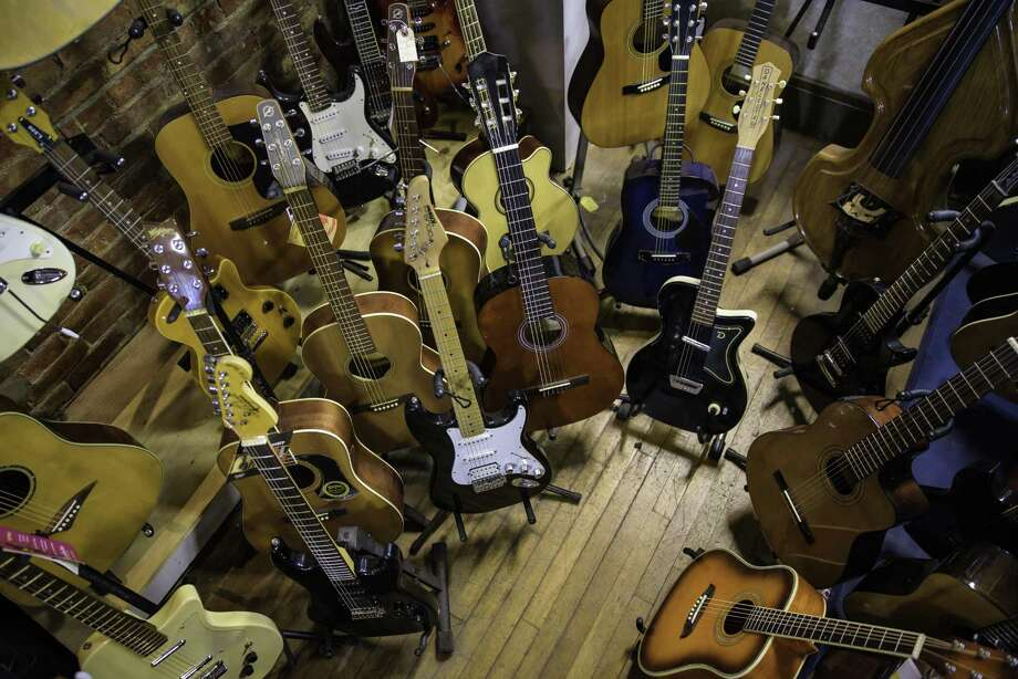 Guitars and more guitars at the Music Guild in Danbury. Photo: Kyle Michael King / For Hearst Connecticut Media / Hearst Connecticut Media Group Freelance