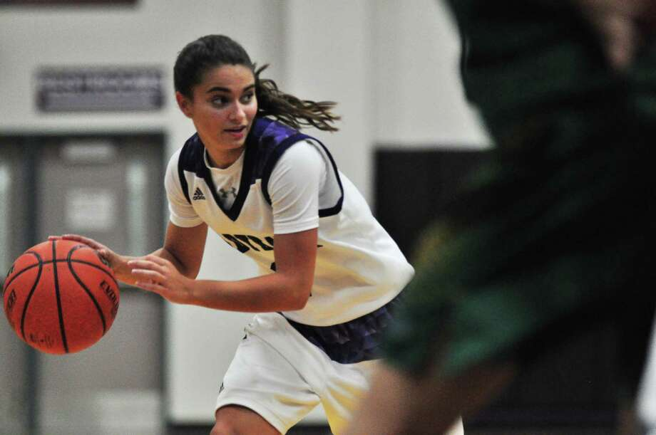 Willis guard Victoria Burkhardt looks for an opening against Klein Forest in a non-district game on Friday at Willis High School. Photo: Keith MacPherson