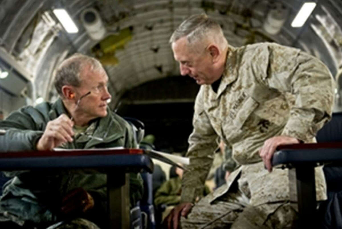 Gen. James Mattis confers with Gen. Martin Dempsey, the former Chairman of the Joint Chiefs of Staff.