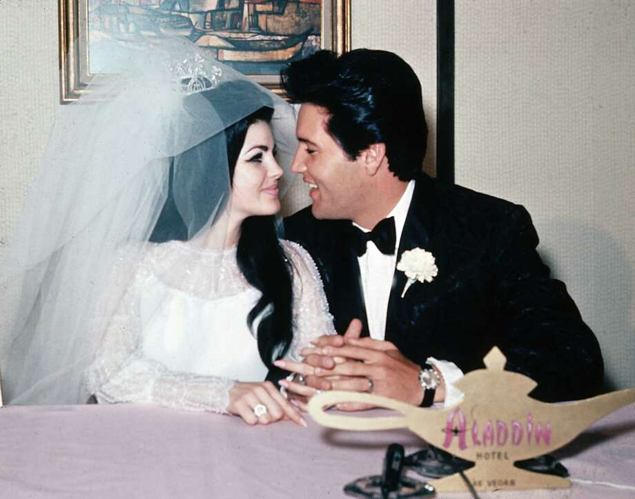 "FILE - In this May 1, 1967, file photo, singer Elvis Presley and his bride, the former Priscilla Beaulieu, appear at the Aladdin Hotel in Las Vegas, after their wedding. Priscilla Presley opened up about her life with Elvis during a Nov. 16, 2016, interview on British chat show, ""Loose Women,"" on the ITV network. (AP Photo/File) ORG XMIT: PAPM102 Photo: Uncredited / Copyright 2016 The Associated Press. All rights reserved."