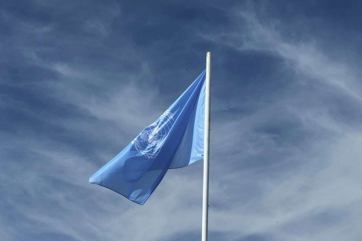 """The U.N flag is seen prior to the opening session of the high level segment of the U.N. climate conference in Marrakech, Morocco, Tuesday, Nov. 15, 2016. French President Francois Hollande on Tuesday urged the United States to respect the """"irreversible"""" Paris Agreement on climate change, and said France will lead a dialogue on the topic with President-elect Donald Trump """"on behalf of the 100 countries that have ratified"""" the deal. (AP Photo/Mosa'ab Elshamy)"""