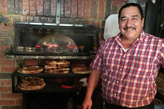 """Luigi """"Domenic"""" Ciccarelli, the son of the late La Focaccia Italian Grill founder Luigi Ciccarelli, at the restaurant's wood-burning pizza oven. La Focaccia has announced that it's for sale after 20 years in business at 800 S. Alamo St. in San Antonio."""