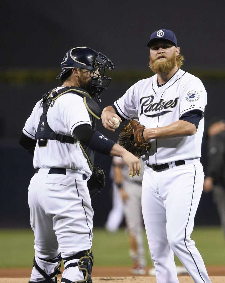 SAN DIEGO, CA - SEPTEMBER 23:  Pitcher Andrew Cashner #34 of the San Diego Padres talks with catcher Derek Norris #3 during the first inning of a baseball game against the San Francisco Giants at Petco Park September 23, 2015 in San Diego, California.  (Photo by Denis Poroy/Getty Images) ORG XMIT: 538595485 Photo: Denis Poroy / 2015 Getty Images