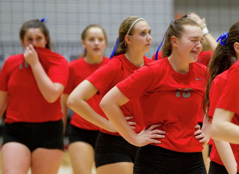 Oak Ridge's Hailey Lohnes (15) reacts as players make their way off the court after losing to Lewisville Hebron in straight sets during Class 6A state semifinal match during the UIL State Volleyball Championships at the Curtis Culwell Center Friday, Nov. 18, 2016, in Garland. Photo: Jason Fochtman, Staff Photographer / Houston Chronicle