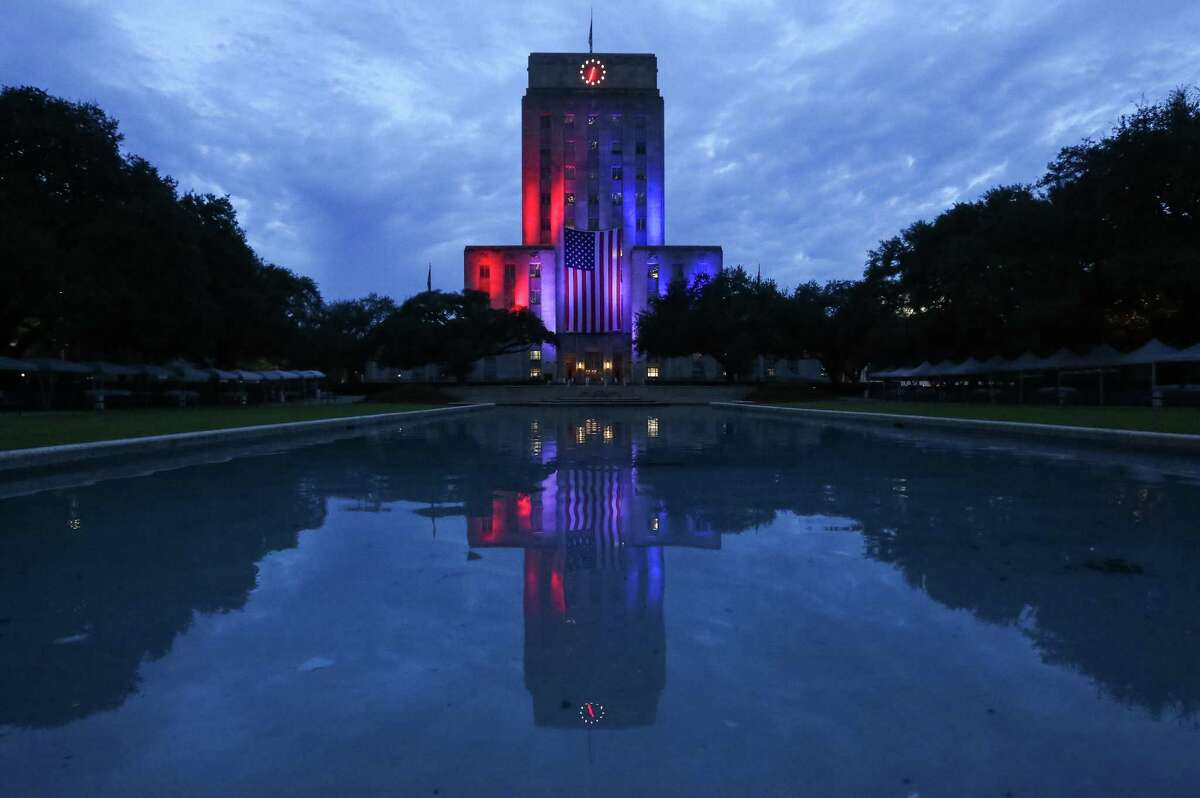 Lights shine on Houston City Hall at sunrise to celebrate Veterans Day 2016.