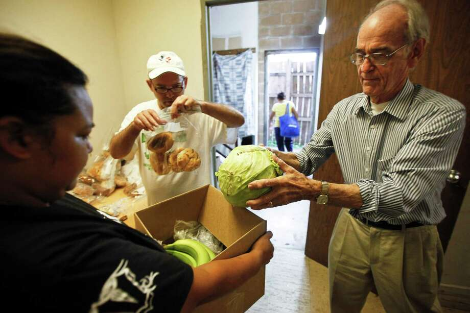 Mark Zwick, right, the founder of Casa Juan Diego, helped distribute food and find shelter for Latino families for nearly four decades. The facility now assists about 500 families a week.   ( Michael Paulsen / Houston Chronicle ) Photo: Michael Paulsen, Staff / © 2011 Houston Chronicle
