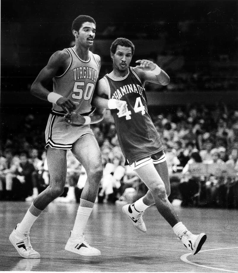 In this Dec. 23, 1982, file photo, Virginia's Ralph Sampson is guarded by Chaminade's Tony Randolph. They were high-school rivals in Virginia, and Randolph even dated Sampson's sister. Photo: Associated Press