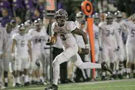 Ridge Point's quarterback Aaron Allen (3) runs the ball in for a touchdown against Lamar during Class 6A, Division I area playoff on Friday, Nov. 18, 2016, in Houston.
