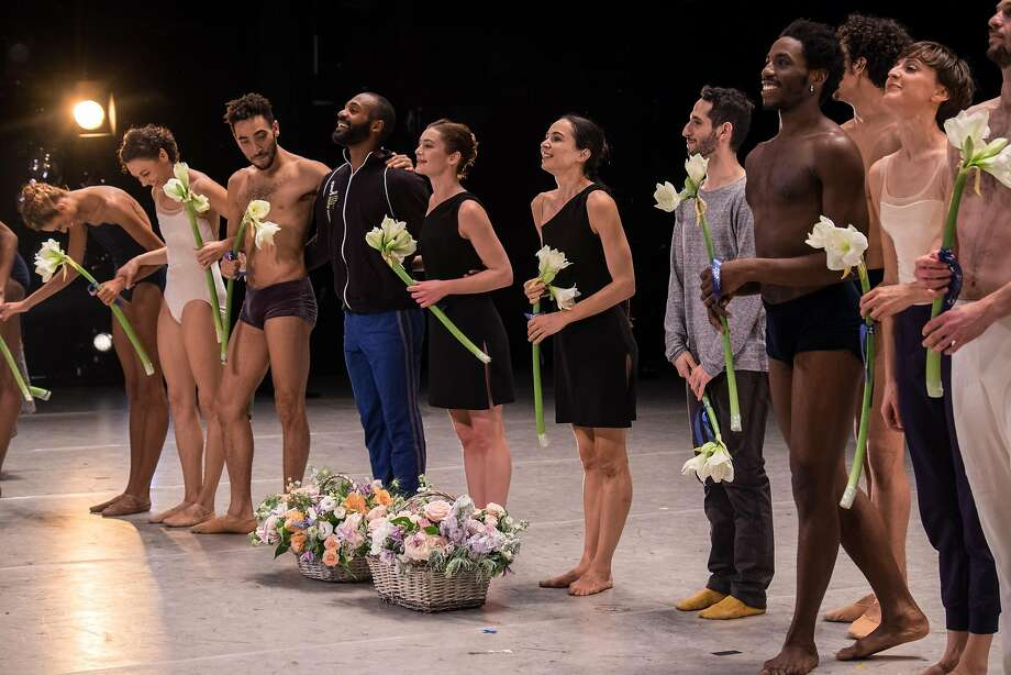 Alonzo King LINES Ballet takes a bow at the Stanislavsky Theater in Moscow, Russia, November 14. They performed there as part of Diana Vishneva's Context festival. The woman in black next to the dancer in gray is Diana Vishneva, the artistic director of the festival.  Photo: Courtesy of Context festival Photo: Courtesy Of Context Festival