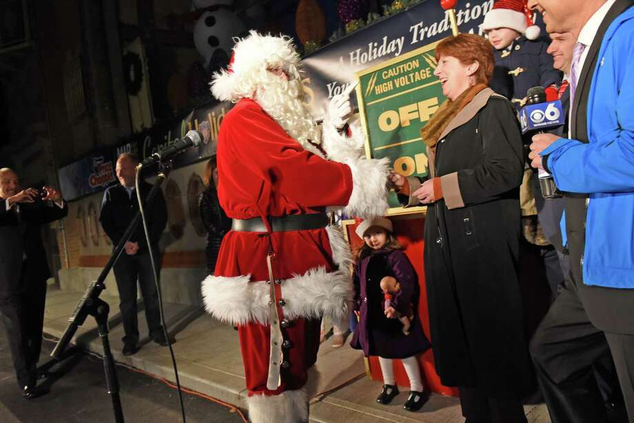 Santa Claus has a word with Mayor Kathy Sheehan as they take part in the season kickoff of the  20th annual Price Chopper/Market 32 Capital Holiday Lights in the Park at Washington Park on Friday Nov. 18, 2016 in Albany, N.Y.  (Michael P. Farrell/Times Union) Photo: Michael P. Farrell / 20038861A
