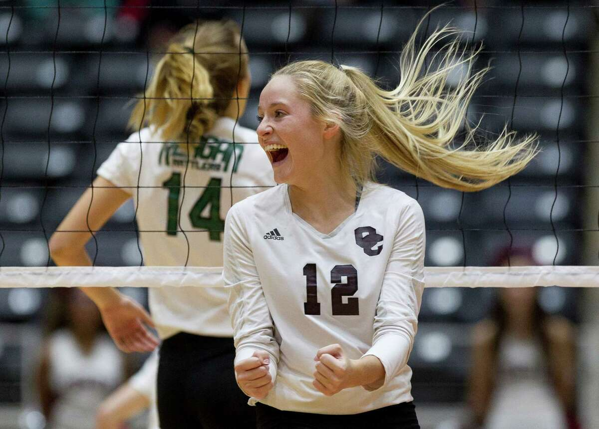 Clear Creek's Hannah Froeschl (12) celebrate after scoring a point in the second set of a Class 6A state semifinal match during the UIL State Volleyball Championships at the Curtis Culwell Center Friday, Nov. 18, 2016, in Garland. Clear Creek swept San Antonio Reagan in to reach the state championship for the first time since 1968.