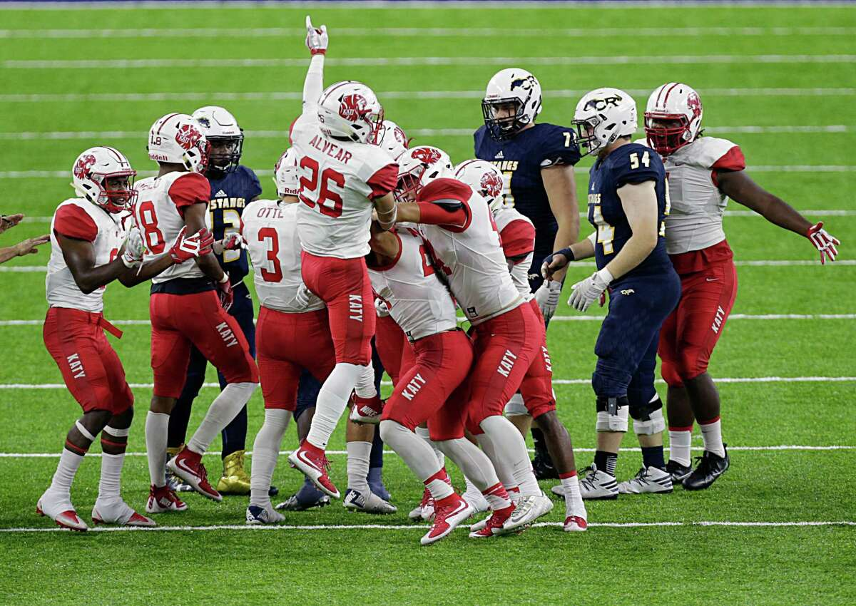 Katy player celebrate after intercepting the ball during second half of Class 6A Division Area playoffs against Cypress Ranch at NRG Stadium Nov. 18, 2016, in Houston.