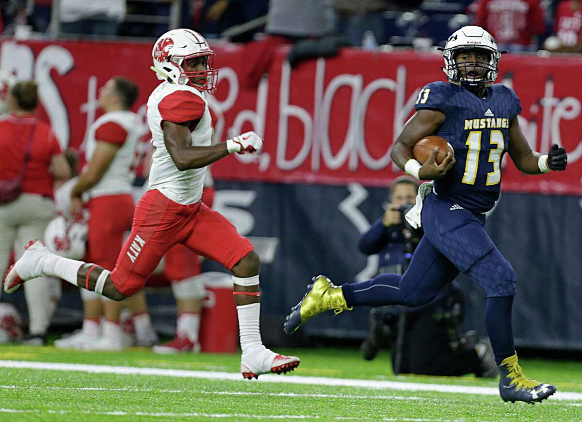 Cypress Ranch's Austin Goffney right, out runs Katy's KeShon Rowe left, for a touchdown during second half of Class 6A Division Area playoffs at NRG Stadium Nov. 18, 2016, in Houston.